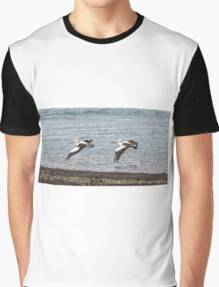 Pelicans flying in unison Graphic T-Shirt