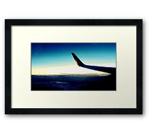 traveling above clouds Framed Print