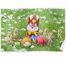 Wrapped Chocolate Bunnies with Easter Eggs in the Grass Poster