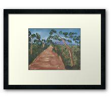 Gum trees along a dirt road. Framed Print