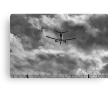 Through the airport fence Canvas Print