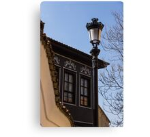 Perfectly Aligned - Intricate Ironwork Streetlight and Classic Revival House Canvas Print