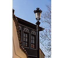 Perfectly Aligned - Intricate Ironwork Streetlight and Classic Revival House Photographic Print