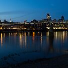 London Skyline Reflecting in the Thames River at Night by Georgia Mizuleva