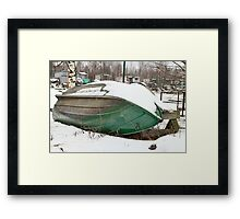 old rowing boat under the snow Framed Print