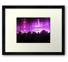 Silhouettes of people enjoying electronic music Framed Print