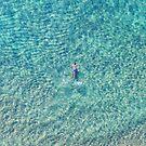 Ocean swimming by Keiran Lusk