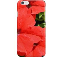 Red flowers on green leaves background. iPhone Case/Skin