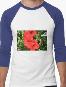 Red flowers on green leaves background. Men's Baseball ¾ T-Shirt