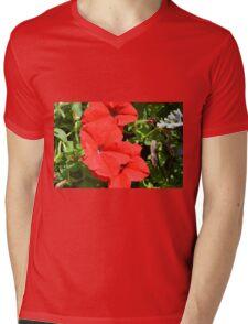 Red flowers on green leaves background. Mens V-Neck T-Shirt
