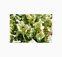 White flowers and green leaves bush in the garden. Unisex T-Shirt