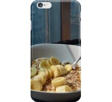 Bowl of cereals with sliced bananas. iPhone Case/Skin