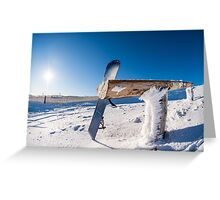 Snowboard leaning on a wood rail Greeting Card