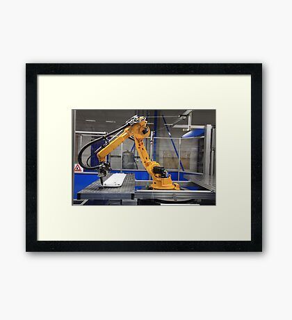 Industrial Robot in manufacturing Framed Print