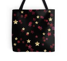Pattern print with glitter textured red gold stars confetti print on black background Tote Bag