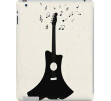 guitar with notes flying on the background,vector illustration iPad Case/Skin