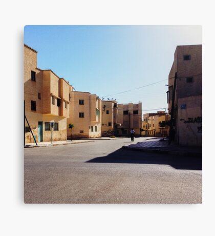 Man Riding Bicycle Through Moroccan Suburb Canvas Print