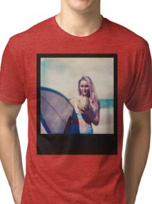 Polaroid of Blond Female Surfer Girl Holding Surfboard and Drinking Fresh Coconut Tri-blend T-Shirt