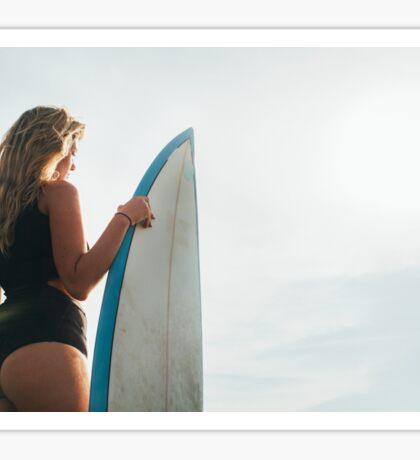Rio de Janeiro - Pretty Blond Female Surfer Girl Standing Next to Surfboard in Warm Morning Light Sticker