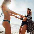 Two Young Pretty Girls Having Fun Together on Sunny Beach by visualspectrum