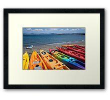 Multi colored kayaks. Framed Print
