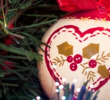 Red Christmas ornament retro ball hanging on Christmas tree with holly Sticker