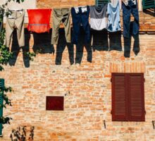 Laundry Drying on Washing Line Against Old Brick Building in Tuscany Italy Sticker