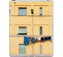 Laundry Drying on Washing Line Against Yellow Building Facade in Italy iPad Case/Skin