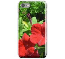 Red flowers, natural background. iPhone Case/Skin