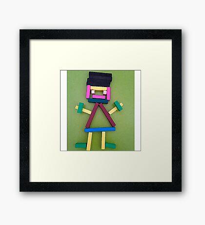 Doll Sticks Framed Print