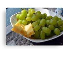 Yellow grapes and cheese. Canvas Print