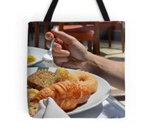 Man eating breakfast, plate with croissant, omelette, bread. Tote Bag