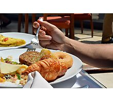 Man eating breakfast, plate with croissant, omelette, bread. Photographic Print