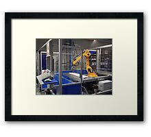 Industrial robotic arm in a factory Framed Print