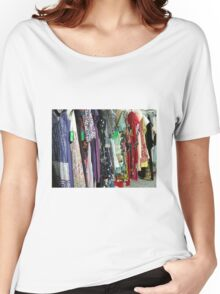 an op shop rack full of bright colourful hippy clothes Women's Relaxed Fit T-Shirt