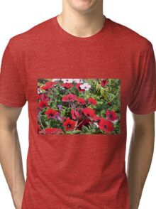 Beautiful red flowers in the park. Tri-blend T-Shirt