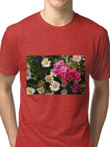 Colorful pink and white flowers in the garden. Tri-blend T-Shirt