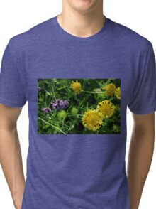 Yellow flowers, natural background. Tri-blend T-Shirt