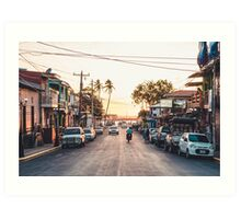 Sun sets in the village Art Print