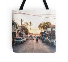 Sun sets in the village Tote Bag