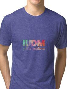 IUDM Public Relations Sticker Tri-blend T-Shirt
