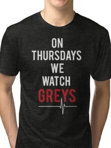 on thursdays we watch greys Tri-blend T-Shirt
