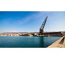 An old crane in the port of Trieste Photographic Print