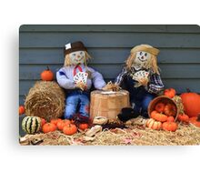 Scarecrows on brake don't guard harvest and crow eat corn Canvas Print