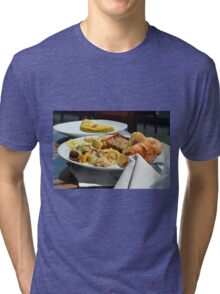 Healthy breakfast with omelette, vegetables and croissant. Tri-blend T-Shirt