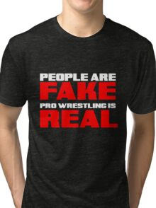 People are fake Pro Wrestling is real Tri-blend T-Shirt