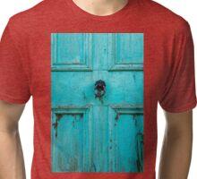 What lies behind the blue door Tri-blend T-Shirt