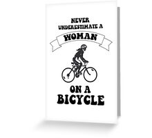 Never underestimate a woman on a bicycle Greeting Card