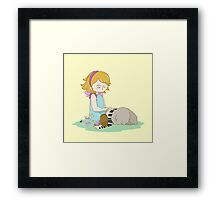 Cute girl playing piano Framed Print