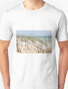 Ocean beach, sand dune, and protective fence Unisex T-Shirt